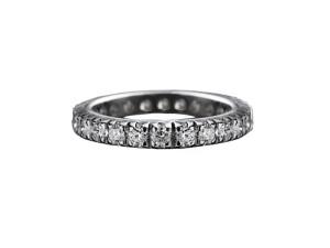 103 - Anello classico in oro bianco e diamanti naturali